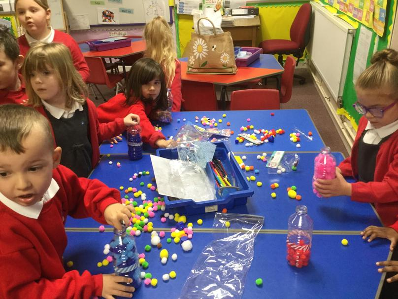 We sorted and counted Pom poms.