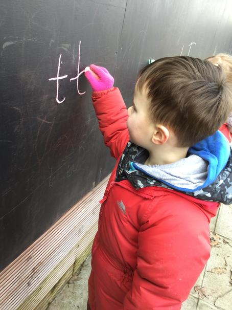 Mark making on our giant black board