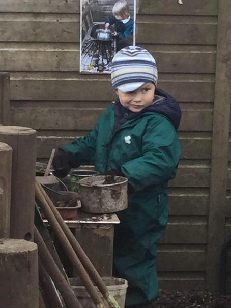 Busy in the mud kitchen