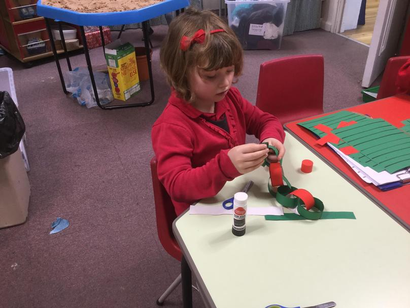 We made some Christmas paper chains.