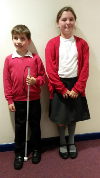 Lennox and Chloe model a good example of school uniform