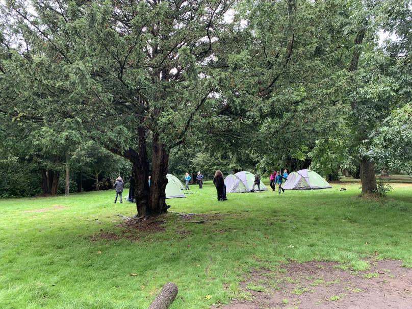 Children select camp spot