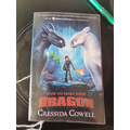 Alfie is reading How to Train Your Dragon