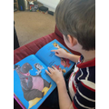 Can you guess what book Thomas is reading?