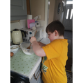 Alfie making cakes.