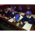Y3/4 having lessons in a Victorian Schoolroom
