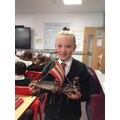 Madison showing the pupils a Viking longship.