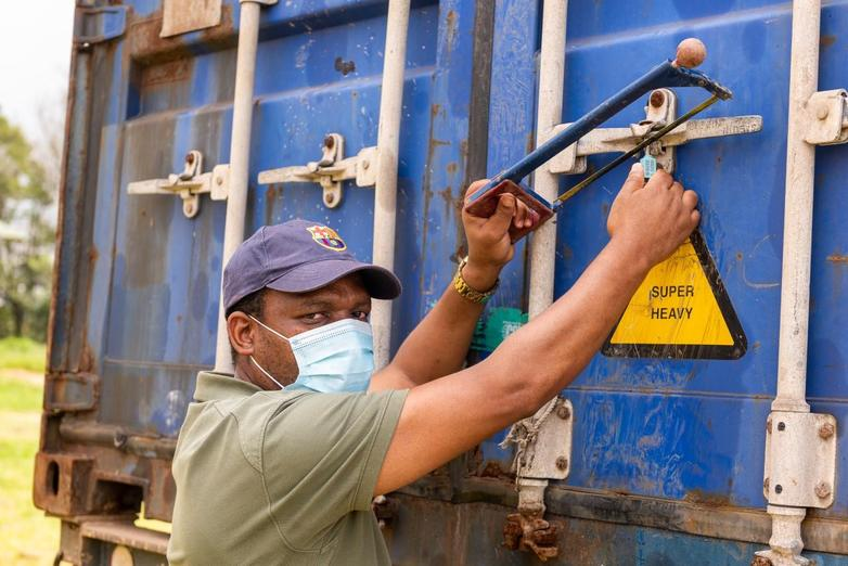 Pastor Timothy (with us in 2017) opens the container in Swaziland after weeks of travel