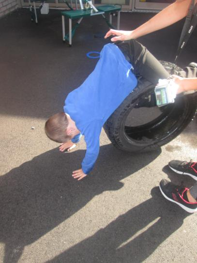 Oliver exercising on a tyre
