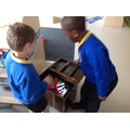 The boys find things to sell in their pirate shop.