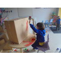 Developing our gross motor skills whilst painting.
