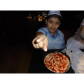 How delicious does Akram's pizza look?