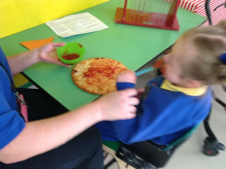 Sian mark making with passata on a pizza base