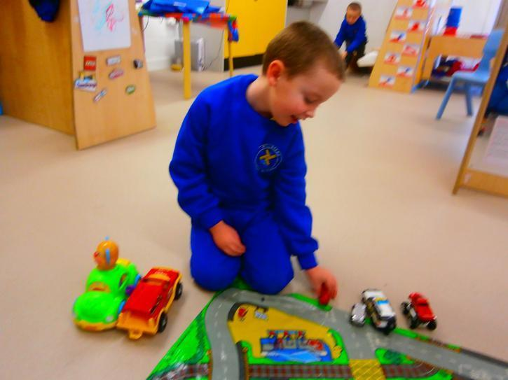 Charlie sorting the cars into big and small