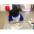 Lois mark making in flour.
