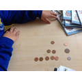 Mustafa was making amounts using coins to 5p.
