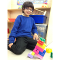 Sami creating a leaning tower!