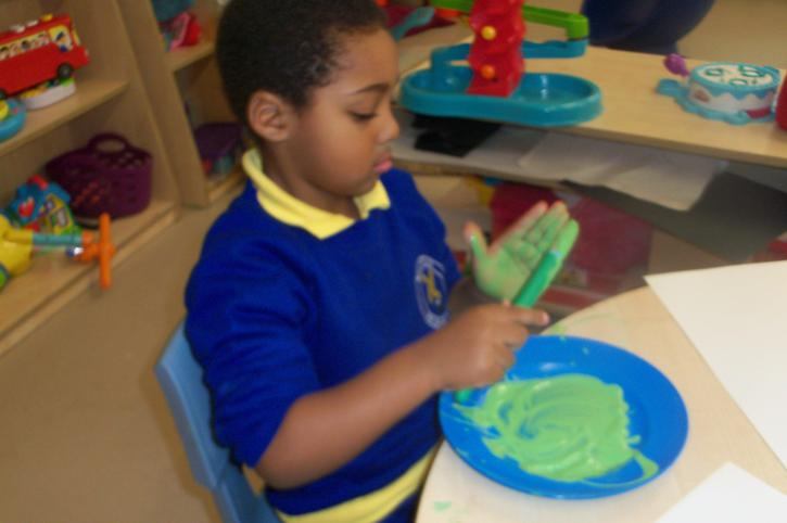 Independently painting his hands to print
