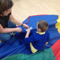 The children ask for pulls on the parachute