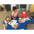 Grace and Liliana completing creative activity together