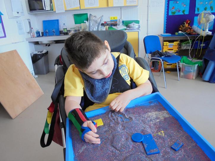 Searching for shapes in sand.