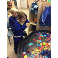Emily explored the sensory tray with friends.