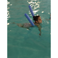 Jury using her noodle to practice her swimming