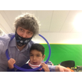 Assen and Nick enjoyed exploring the hula hoop when learning about circles!