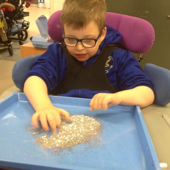 Oliver loved making glittery things!