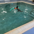 Salma is learning to travel across the pool.