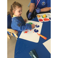 Poppy using fruit to print in a creative session