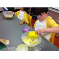 Jack adding ingredients into his mixture