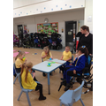 The children sitting at the cafe at the end of our MOVE PE circuit