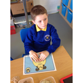 Leo developed fine motor skills in playdough