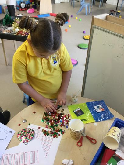 Layla busy making tree decorations.