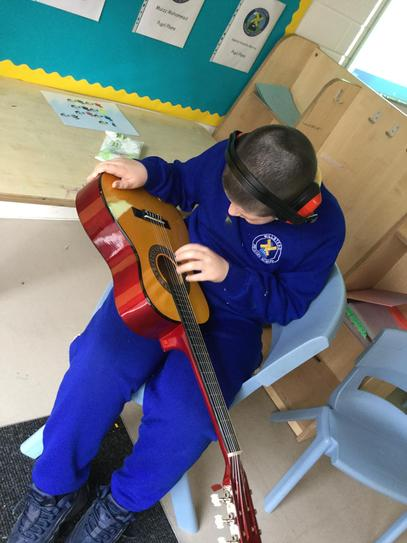 Playing the guitar is a great way of working on our fine motor skills.
