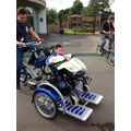 Zhi Peng enjoys being on the wheelchair bikes!