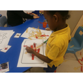 Hafsa independently using art materials