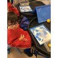 Leo enjoys sensory play activities.
