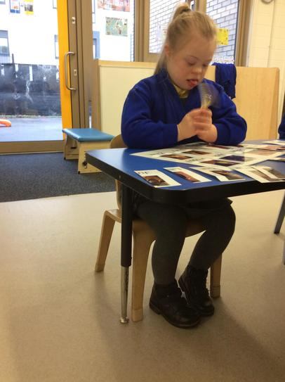23/5 Grace sitting on a regular class chair ready for work.