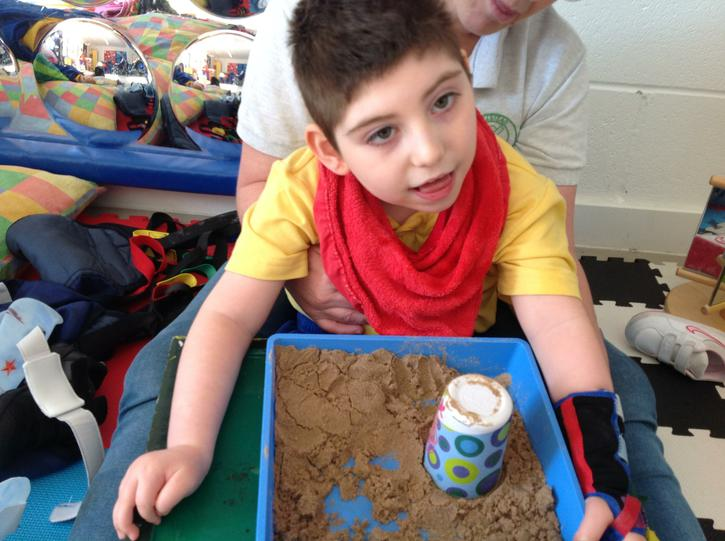 Jake building sandcastles to count.