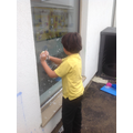 We washed the window to develop gross motor skills