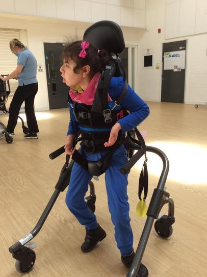 25/5Emily in her walker looking for her friend
