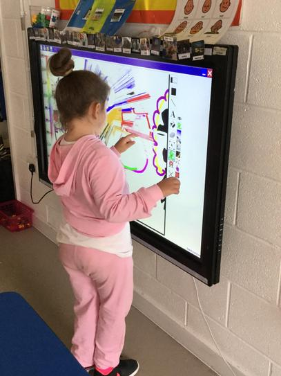 Using our interactive board to draw.