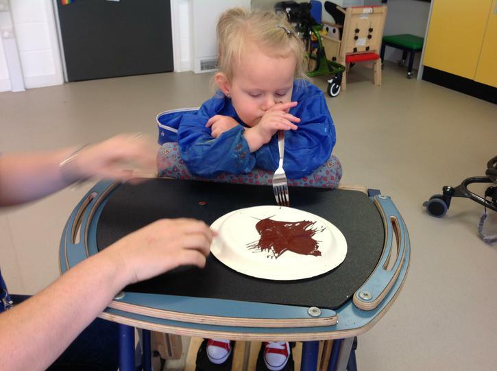 Liliana using a fork to create a fur effect