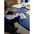 Elliot practising writing his name.