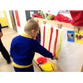 Mason creating the stripes for his circus tent