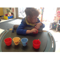 Emily counting cups in numeracy