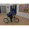 Oliver cycling his bike around school
