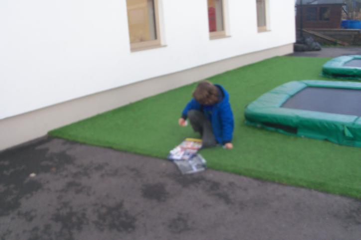 Connor using his communication book outside!